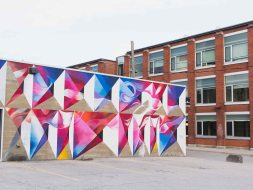 Mural in the Bread Factory plaza with the University of Waterloo School of Architecture in the background.